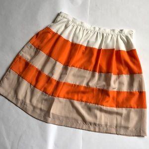 Eci Orange, white and beige skater skirt.